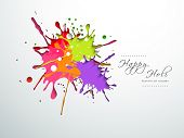 Indian festival Happy Holi celebration concept with colors splash on grey background.