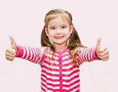 Cute Happy Little Girl With Thumbs Up