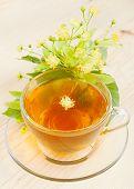 Linden Flowers And Cup Of Healthy Tea, Herbal Medicine