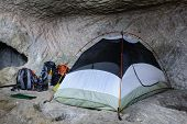 Camp, backpacks and one tent in the cave