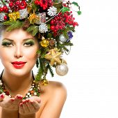 Beautiful New Year and Christmas Holiday Woman. Christmas Tree Hairstyle and Make up. Beauty Fashion