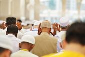 stock photo of muslim man  - Muslim people in crowd - JPG