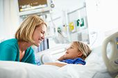 stock photo of intensive care unit  - Mother Talking To Daughter In Intensive Care Unit - JPG