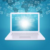 stock photo of ebusiness  - Emails fly out of laptop screen - JPG