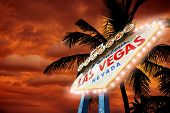 stock photo of sinful  - Fabulous Vegas Entrance Sign with Palms and Sunset Sky - JPG