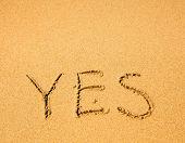 Yes - written in sand on sea beach texture.