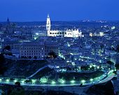 View over city at night, Toledo, Spain.