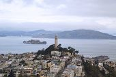 Areal view of Coit Tower and streets of San Francisco in the front of Alcatraz island