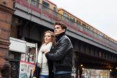 Couple Looking Away Against Train Bridge