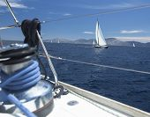 Sailing yachts in the sea at race.