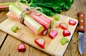 Rhubarb Cut On Board With Knife