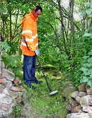 Man Using A Metal Detector