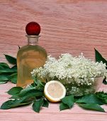 pic of elderberry  - Syrup of flowers elderberry on wooden background - JPG