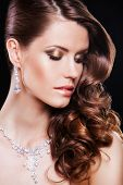 close up portrait of beautiful brunette woman with luxury accessories.