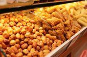 stock photo of phyllo dough  - Nuts and baklava on market shelf - JPG