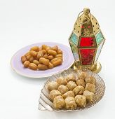 Traditional Ramadan lantern and assorted arabic sweets - isolated objects