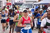 Male And Female Runners At Comrades Marathon