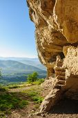 Caves at Tepe Kermen, Crimea, in the morning rays of sunlight