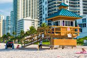 MIAMI,USA - MAY 26,2014 :Iconic lifeguard tower in South Beach on a beautiful summer day with high rise buildings on the background