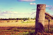 Retro Sunset Filter Style Country Side Scene With Old Gate Post And Barb Wire. Taken At Barossa Vall