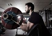 stock photo of beard  - biceps preacher bench arm curl workout man at fitness gym - JPG
