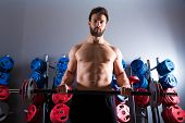 Barbell beard man workout fitness at weightlifting gym