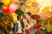 picture of candy cotton  - Happy young  couple eating cotton candy in amusement park - JPG