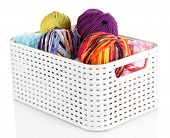 Plastic basket with yarn for knitting isolated on white