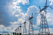 picture of transmission lines  - Pylon And Transmission Power Line In Summer Day - JPG