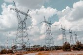 image of power transmission lines  - Pylon And Transmission Power Line In Summer Day