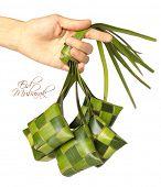 Hand Held Muslim Ketupat (Rice Dumpling) with Clipping Path. Translation: Eid Mubarak - Blessed Feast