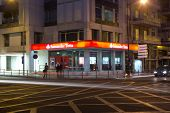 LISBON, PORTUGAL - MAY 28, 2014: Banco Santander Totta at night in Lisbon. Banco Santander Totta  is