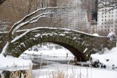 New York City and snow covered arch in Central Park