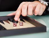 Businessman Playing Backgammon