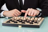Businessman Playing Checkers