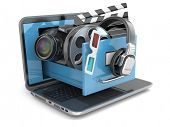 Multimedia concept. Laptop, camera , headphones and video attributes. 3d
