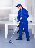 Male Worker Cleaning Floor