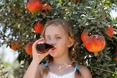 Young Girl Drinking Pomegranate Juice