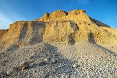stock photo of sand gravel  - Sand quarry in evening light the place where gravel are transported to construction sites - JPG