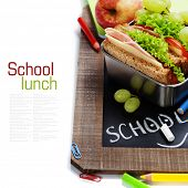 stock photo of lunch box  - school lunch and  blank chalk board over white - JPG