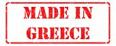 Made in Greece - inscription on Red Rubber Stamp.