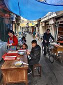 Outdoor Eatery In Narrow Street Of Shanghai, Chinese Fastfood.