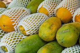 stock photo of groping  - Papaya In Morning Market For Food Ingredient ** Note: Shallow depth of field ** Note: Visible grain at 100%, best at smaller sizes - JPG