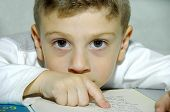 picture of storytime  - young boy reading a book - JPG