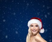 Beautiful woman in Christmas cap,snow background