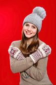 Beautiful girl in  knitted hat and gloves