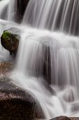 Close-up of a waterfall during the autumn near the Queimadela Dam in the Municipality of Fafe. Portugal