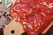 Chopped Fresh Chorizo Sausage On A Cutting Board Close Up.