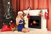 Beautiful Woman Near The Fireplace In Winter House. Selebrating Christmas