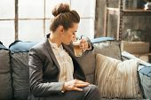 picture of latte  - Business woman drinking coffee latte in loft apartment - JPG